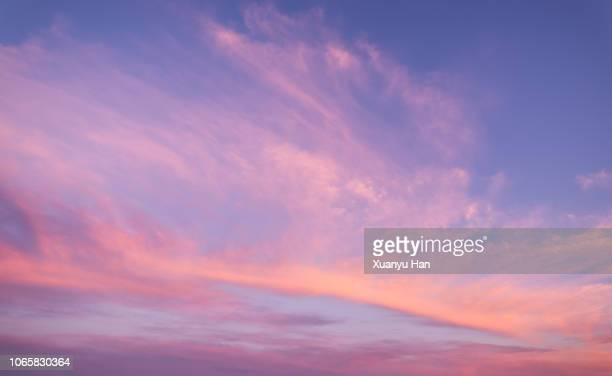 sunrise cloudscape with purple sky - colorful sunset stock photos and pictures