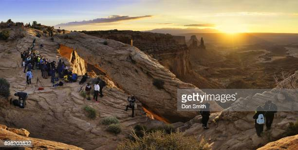 sunrise crowd at mesa arch - don smith stock photos and pictures