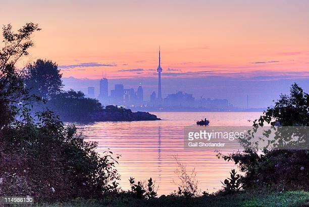 sunrise fishing in toronto - lake ontario stock pictures, royalty-free photos & images