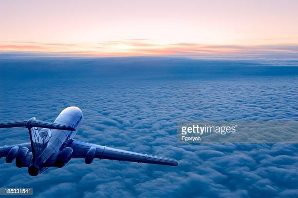 sunrise flight - plane stock photos and pictures