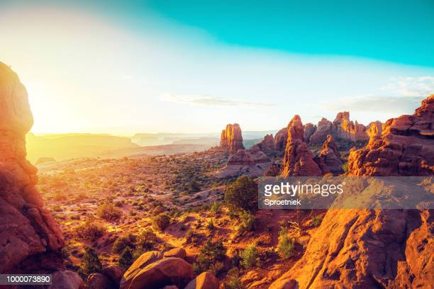 sunrise from north window arch, utah - golden hour stock pictures, royalty-free photos & images