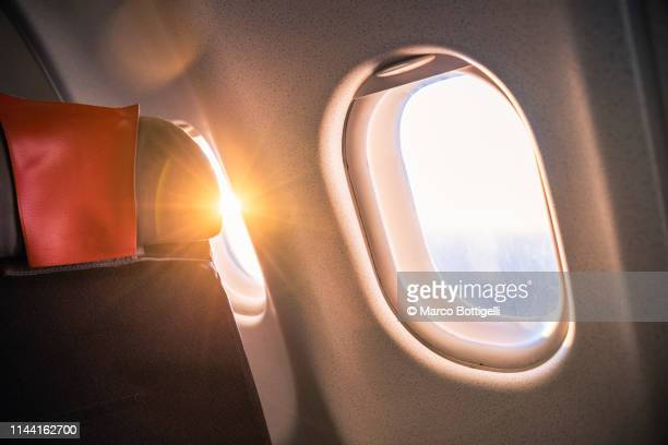 Sunrise from passenger airplane seat