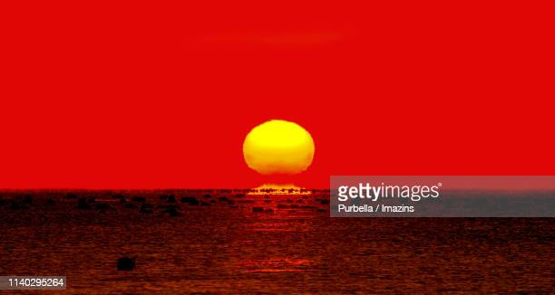 sunrise from sea, yeosu, south korea - purbella stock photos and pictures