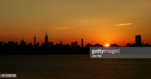 Sunrise highlights silhouettes of Midtown Mahattan's skyline