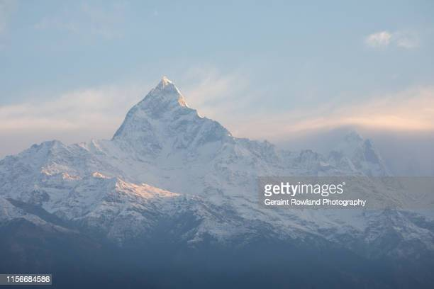 sunrise himalayas - annapurna south stock photos and pictures