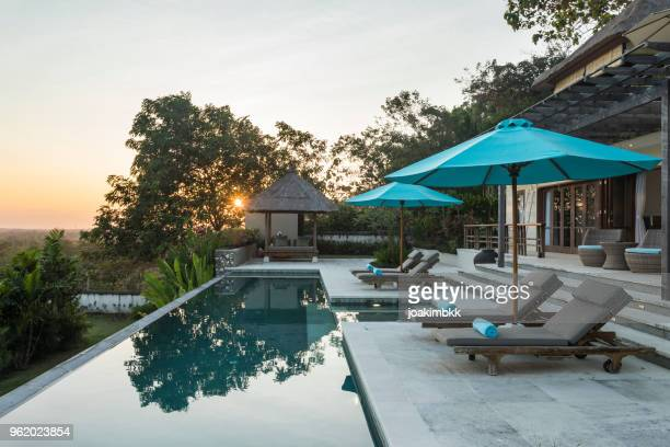 Sunrise in a luxurious villa with swimming pool in Bali
