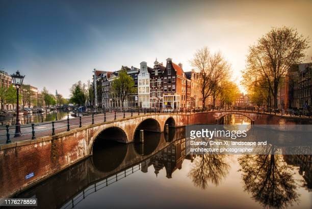 sunrise in amsterdam - amsterdam stock pictures, royalty-free photos & images