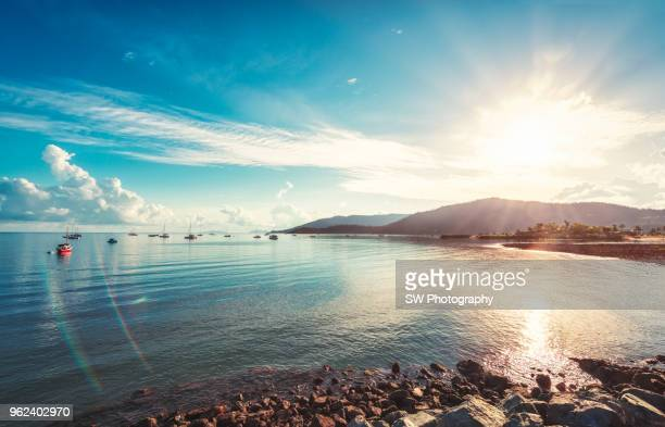 sunrise in arlie beach - sunny stock pictures, royalty-free photos & images