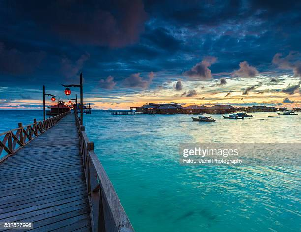sunrise in mabul islands - mabul island stock photos and pictures