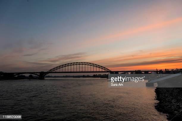 sunrise in nijmegen, netherlands. - nijmegen stock pictures, royalty-free photos & images