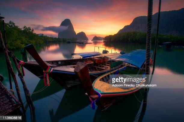 sunrise in phang-nga bay. - phuket province stock pictures, royalty-free photos & images