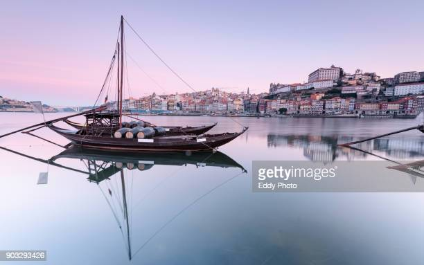 sunrise in porto along the douro river from gaia - porto portugal stock pictures, royalty-free photos & images