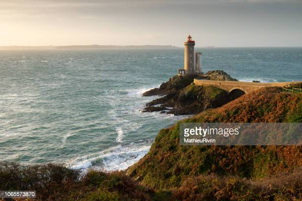 """sunrise in """"rade de brest"""" in the front of the petit minou lighthouse - brest brittany stock pictures, royalty-free photos & images"""