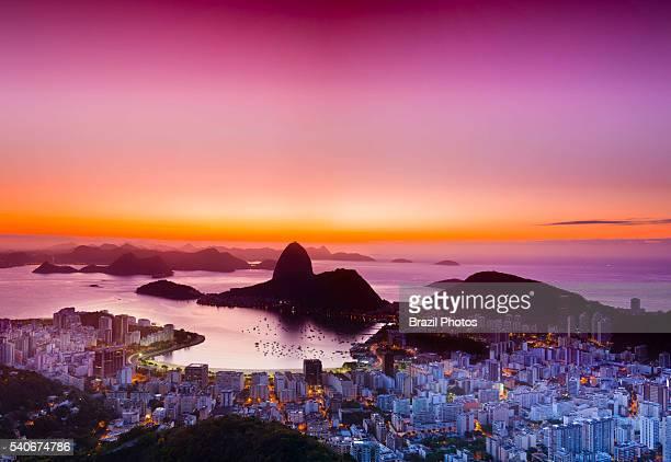 Sunrise in Rio de Janeiro Brazil Sugar Loaf mountain at entrance of Guanabara Bay with Enseada de Botafogo in the center and Botafogo neighborhood at...