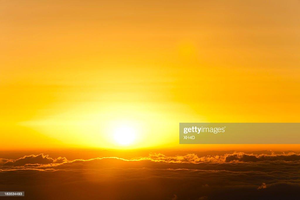 sunrise in sea of clouds : Stock Photo