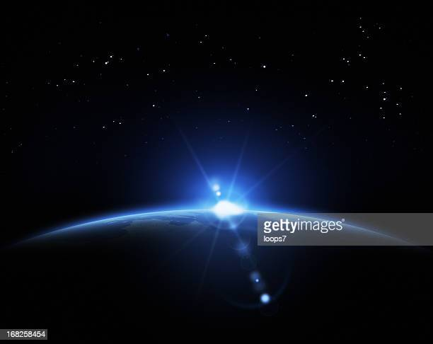 sunrise in space - horizon over land stock photos and pictures