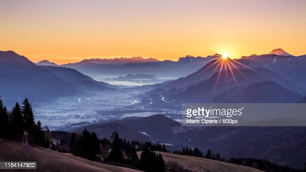 sunrise in the austrian mountains - carinthia stock pictures, royalty-free photos & images