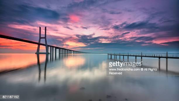 Sunrise in The Vasco da Gama bridge Lisbon