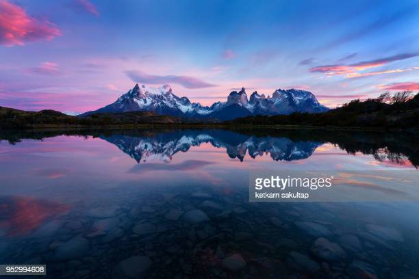 sunrise in torres del paine national park, patagonia, chile. - reflection lake stock photos and pictures