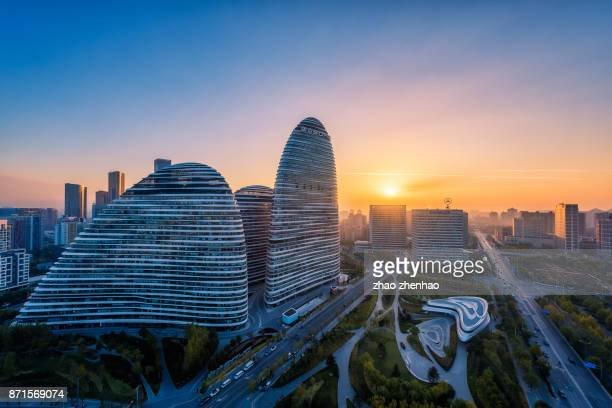 sunrise in wangjing - beijing province stock photos and pictures