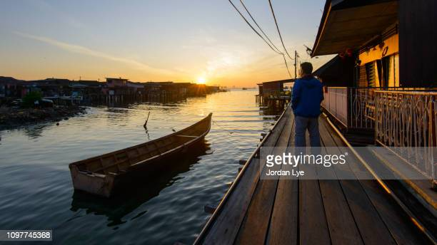 sunrise in wooden jetty - george town penang stock photos and pictures
