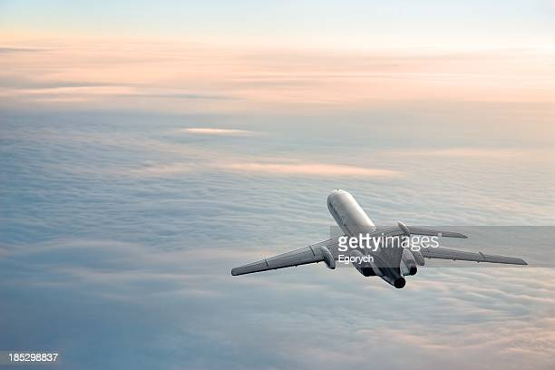 sunrise journey - aircraft stock photos and pictures