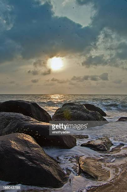 sunrise kovalam beach - tamil nadu stock pictures, royalty-free photos & images