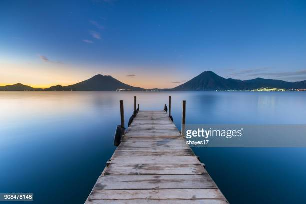 sunrise lake atitlán - pier stock pictures, royalty-free photos & images