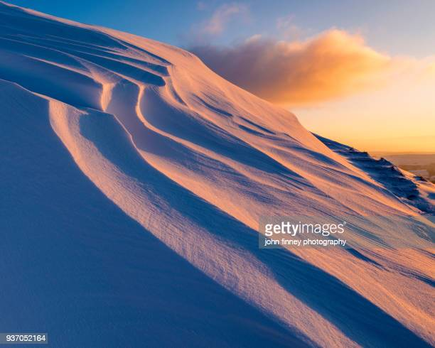 Sunrise light on snowdrifts, high up in the High Peak of Derbyshire.