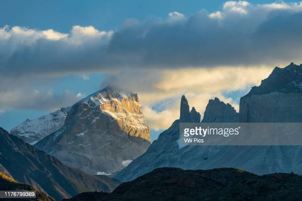 Sunrise light on the southeast face of Torre Sur or Torre D'Afostini in Torres del Paine National Park. A UNESCO World Biosphere Reserve in Chile in...