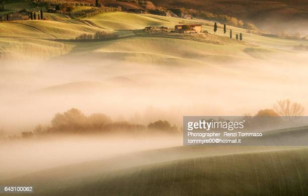 Sunrise light on Val D'Orcia hills with fog