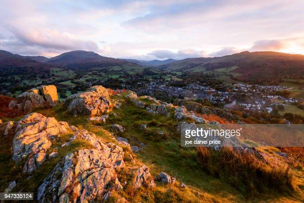 sunrise, loughrigg fell, ambleside, lake district, cumbria, northwest england - ambleside stock photos and pictures