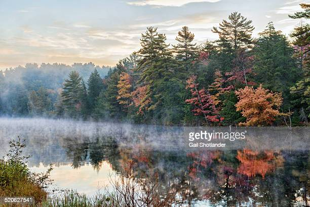 sunrise mist in fall, muskoka river - ontario canada photos et images de collection