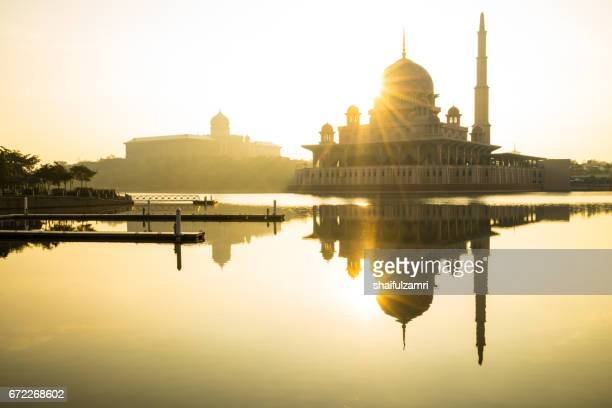 sunrise moment  at putra mosque,   a principal mosque of putrajaya, malaysia. - shaifulzamri stock pictures, royalty-free photos & images