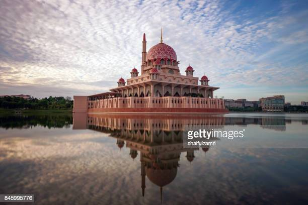sunrise moment at putra mosque, a principal mosque of putrajaya, malaysia. - floating mosque stock pictures, royalty-free photos & images