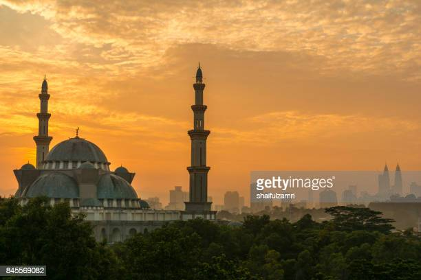 Sunrise moment at The Federal Territory Mosque. This is one of the major mosque in Kuala Lumpur, The mosque's design is a blend of Ottoman and Malay architectural styles.