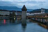 Sunrise of Baroque Cathedral and Chapel Bridge, Kapellbruecke On Luzern Waterfront