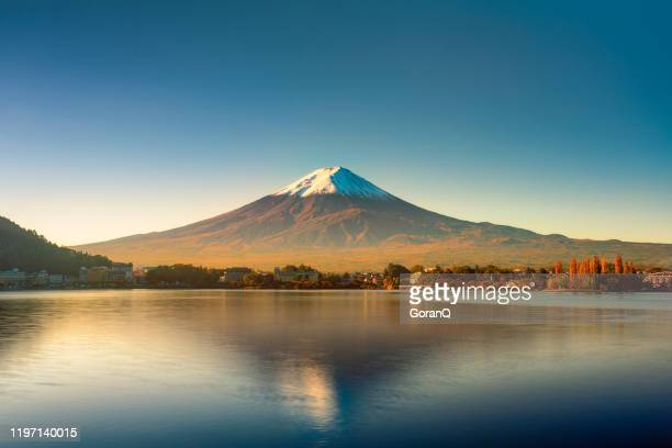 sunrise of fuji mountain reflection on water - hokkaido stock pictures, royalty-free photos & images