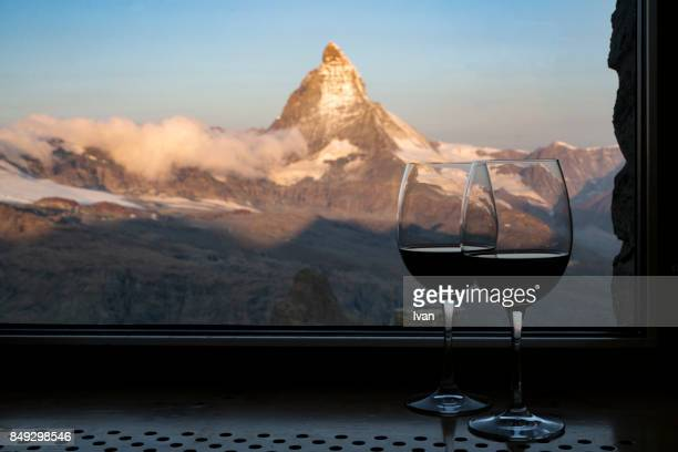 sunrise of the matterhorn (4478m) with couple of wine glass, pennine alps at sunrise, focus on wine glass - valais canton stock pictures, royalty-free photos & images