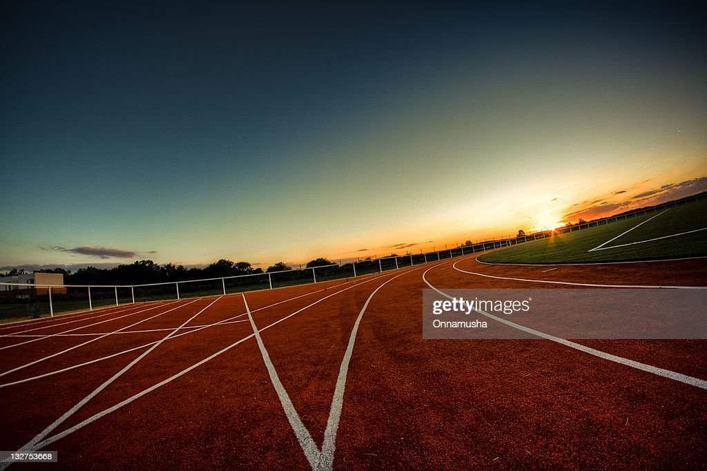 Sunrise on athletics track : Stock Photo