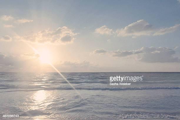 Sunrise on beach with Ocean