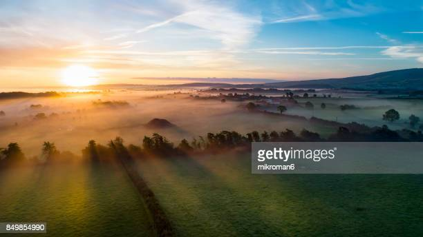Sunrise on foggy day over Tipperary mountains and fields
