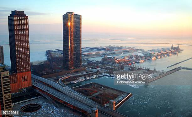 sunrise on frozen lake michigan navy pier chicago in winter - navy pier stock pictures, royalty-free photos & images