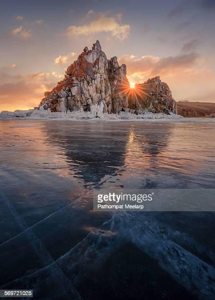 Sunrise on frozen lake(Shamanka Rock, Lake Baikal)