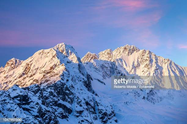 sunrise on monte disgrazia, italy - ridge stock pictures, royalty-free photos & images