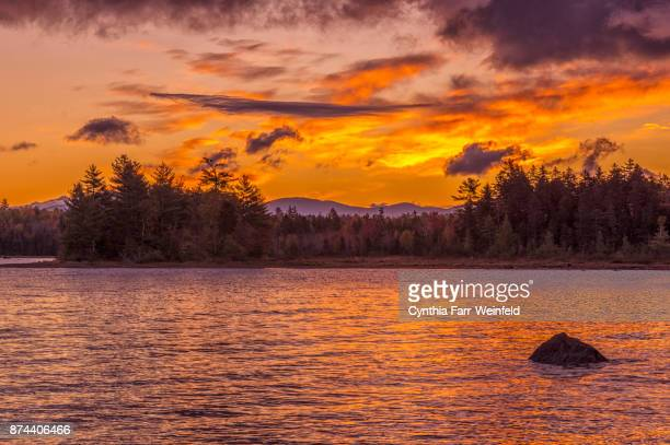 sunrise on moosehead lake - moosehead lake stock photos and pictures