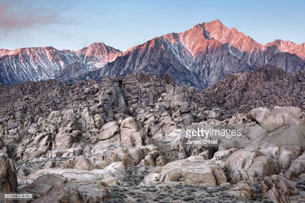 Sunrise on mountains and rocky foreground, Alabama Hills, Sierra, California