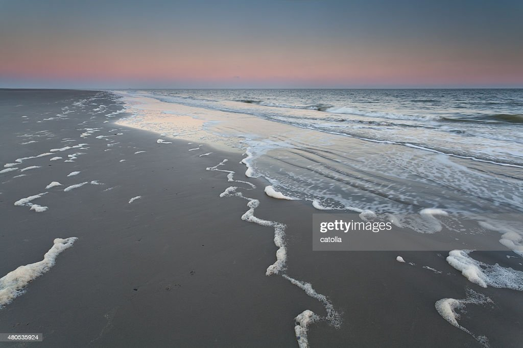 sunrise on north sea beach : Stockfoto