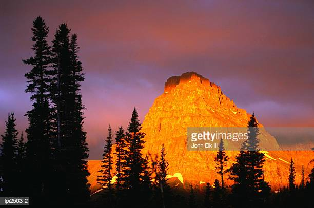 sunrise on sinopah mountain at two medicine lake - glacier national park, montana,glacier national park,montana,united states of america,north america - two medicine lake montana stock photos and pictures