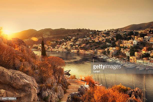 sunrise on symi, greece - symi stock photos and pictures
